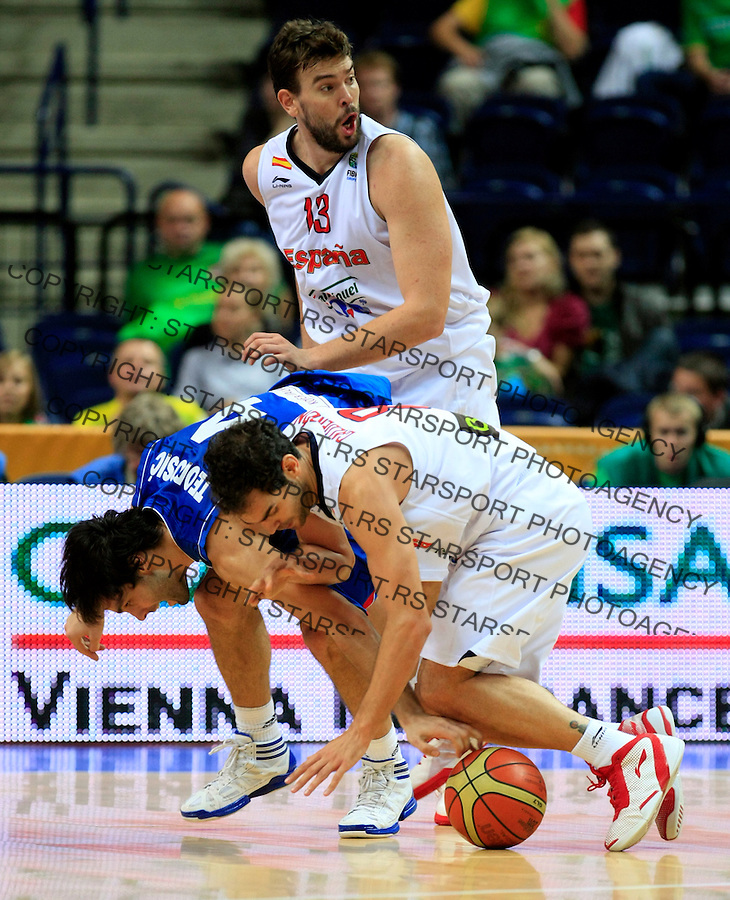 Spain national basketball team playesr Calderon Jose and Marc Gasol (13) fights for the ball with Serbian Milos Teodosic during round 2, group E, basketball game between Spain and Serbia in Vilnius, Lithuania, Eurobasket 2011, Friday, September 9, 2011. (photo: Pedja Milosavljevic)