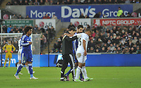SWANSEA, WALES - JANUARY 17:   of  during the Barclays Premier League match between Swansea City and Chelsea at Liberty Stadium on January 17, 2015 in Swansea, Wales. Swansea's Wayne Routledge leaving the field with an injury