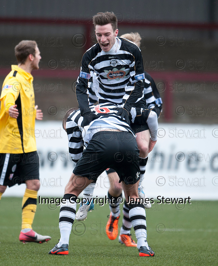 Shire's Max Wright is lifted by Michael Hunter (6) after he scores their first goal.