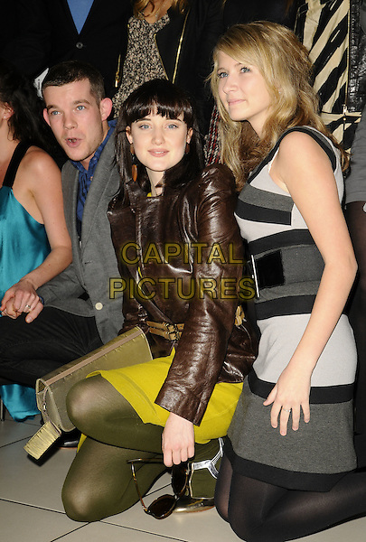 RUSSELL TOVEY, ANDREA RISEBOROUGH & GUEST.The First Light Movie Awards, Odeon Leicester Square Cinema, London, England..March 17th, 2009.full length grey gray suit jacket kneeling bending grey gray yellow dress gold shoes green tights clutch bag brown leather jacket .CAP/CAN.©Can Nguyen/Capital Pictures.