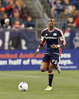 New England Revolution defender Darrius Barnes (25) brings the ball forward. Despite a red-card man advantage, in a Major League Soccer (MLS) match, the New England Revolution tied New York Red Bulls, 1-1, at Gillette Stadium on September 22, 2012.