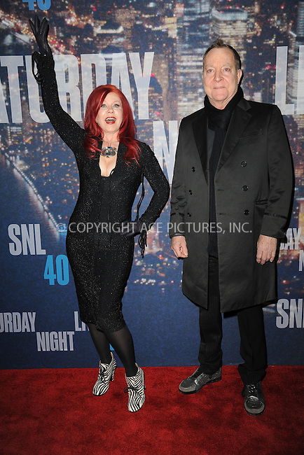 WWW.ACEPIXS.COM<br /> February 15, 2015 New York City<br /> <br /> Kate Pierson and  Fred Schneider walks the red carpet at the SNL 40th Anniversary Special at 30 Rockefeller Plaza on February 15, 2015 in New York City.<br /> <br /> Please byline: Kristin Callahan/AcePictures<br /> <br /> ACEPIXS.COM<br /> <br /> Tel: (646) 769 0430<br /> e-mail: info@acepixs.com<br /> web: http://www.acepixs.com