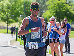 Jeff Webber crosses the finish line as wife Erin holding daughter Mackenzie videos him at the 2019 Reno Tahoe Odyssey at Idlewild Park in Reno on Saturday, June 1, 2019.