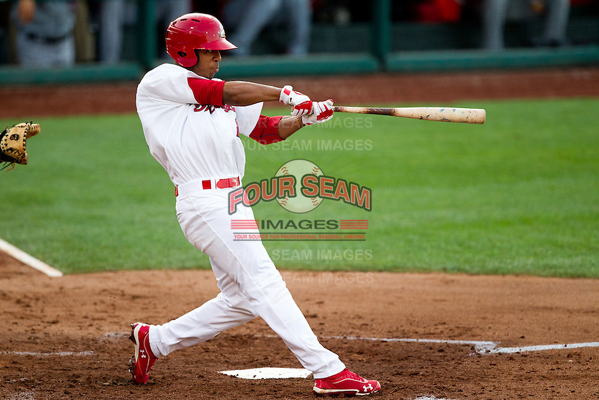 Oscar Taveras (25) of the Springfield Cardinals follows through his swing during a game against the Arkansas Travelers at Hammons Field on June 12, 2012 in Springfield, Missouri. (David Welker/Four Seam Images)
