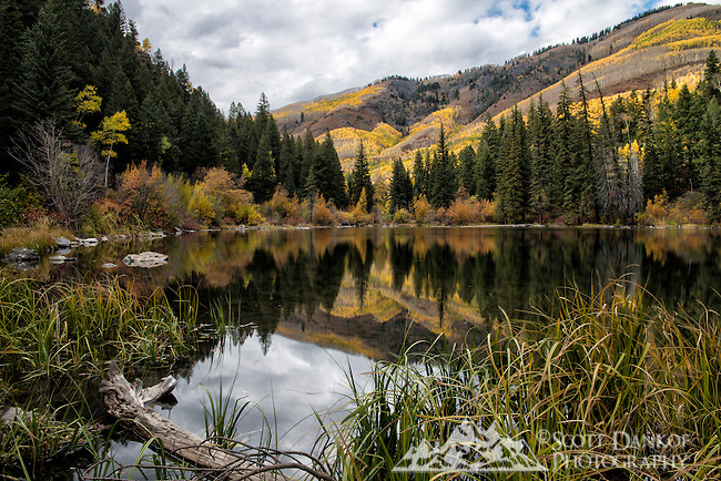 Autumn reflection on Lizard Lake outside Marble, Colorado.