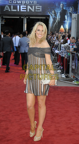 REBECCA FERDINANDO.UK Premiere of 'Cowboys and Aliens' at the Cineworld cinema at the O2 Arena, London, England..August 11th 2011.full length white brown black striped stripes off the shoulder dress silver clutch bag .CAP/CAN.©Can Nguyen/Capital Pictures.