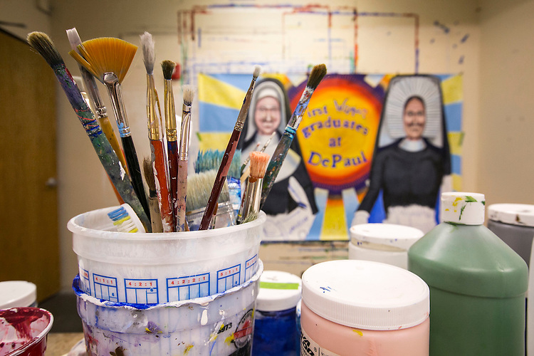 Paint brushes in Brother Mark Elder, C.M., office-based attic at Levan Hall Friday, July, 15, 2016, as he puts the finishing touches on several of the murals, including one featuring DePaul's first female graduates, Sister Mary Teresita and Sister Mary Clemenza Leahy. The artwork will hang under the CTA's Fullerton 'L' stop. Throughout the spring 2016 quarter and into the summer, Br. Mark and his Mural Class students will create several portraits and historically-themed murals that will wrap the support columns underneath the CTA's Fullerton 'L' stop, which runs right through DePaul's Lincoln Park Campus. The murals will depict many prominent, historical figures that have made an impact on DePaul University. (DePaul University/Jamie Moncrief)