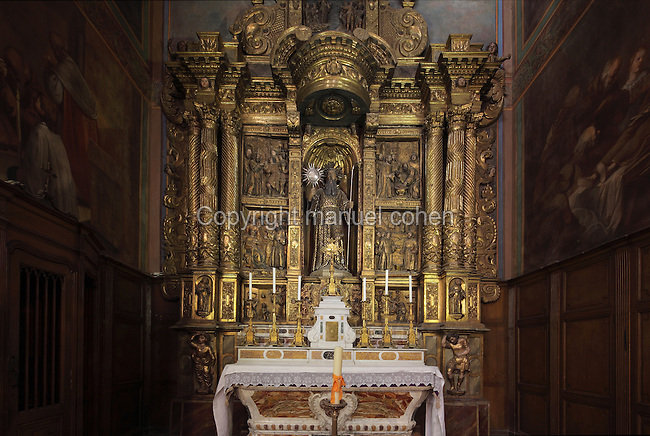 Altarpiece of the St Francois de Paule Chapel, begun 1656 by LLatzer Tremullas and completed 1657 by LLuis Generes, gilded and painted 1666 by Gilles Bedanson, and installed here in 1791, Perpignan Cathedral, Perpignan, Pyrenees-Orientales, France. The central statue depicts St Francois de Paule holding the sun and the staff of the founder. The reliefs show scenes from the life of the saint. The Cathedral Basilica of Saint John the Baptist of Perpignan, or Basilique-Cathedrale de Saint-Jean-Baptiste de Perpignan was begun in 1324 by King Sancho of Majorca in Catalan Gothic style, and later finished in the 15th century. The cathedral is listed as a national monument of France. Picture by Manuel Cohen