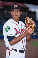 Danville Braves pitcher Jhon Martinez (20) poses for a photo prior to the game against the Pulaski Yankees at American Legion Post 325 Field on August 2, 2016 in Danville, Virginia.  The game was cancelled due to rain.  (Brian Westerholt/Four Seam Images)