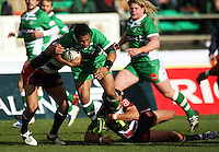 Manawatu centre Johnny Leota is tackled during the Air NZ Cup rugby match between Manawatu Turbos and Counties-Manukau Steelers at FMG Stadium, Palmerston North, New Zealand on Sunday, 2 August 2009. Photo: Dave Lintott / lintottphoto.co.nz