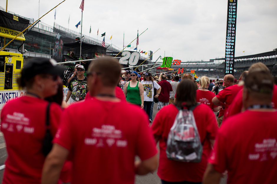 Fans transverse pit road before the Brickyard 400 on Sunday, July 26, 2015, at the Indianapolis Motor Speedway. (Photo by James Brosher)
