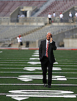 Ohio State assistant coach Kerry Coombs of Cincinnati talks on the phone prior to Saturday's NCAA Division I football game at Ohio Stadium in Columbus on September 27, 2014. (Columbus Dispatch photo by Jonathan Quilter)