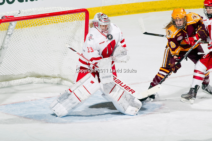 Wisconsin Badgers goalie Alex Rigsby (33) makes a save during an NCAA women's hockey game against the Minnesota Golden Gophers on October 14, 2011 in Madison, Wisconsin. The Badgers won 3-2. (Photo by David Stluka)