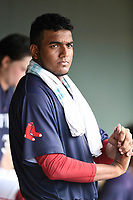 Pitcher Denyi Reyes (41) of the Greenville Drive waits between innings of a game against the Hickory Crawdads 4-1 on Wednesday, July 25, 2018, at Fluor Field at the West End in Greenville, South Carolina. (Tom Priddy/Four Seam Images)