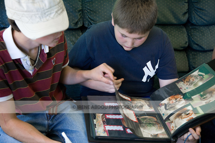 Two children view tattoo samples in a tattoo & piercing parlor in Rockland, Maine.