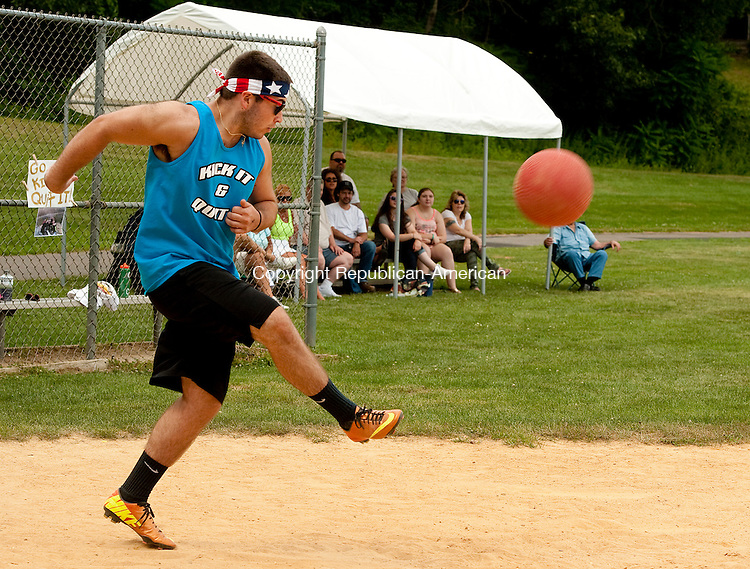 EBACON FALLS, CT--- -080815JS03- Devin Henaghan of team Kick It and Quit It, kicks the ball during the third annual Susie Classic Kickball Tournament held Saturday at the Beacon Falls Recreation Complex in Beacon Falls. 18 teams participated in the day-long event to raise money for the Susie Foundation to help fund research and supporting ALS patients, families, and caregivers in Connecticut. The event is in memory of Susan Ready Matthews who died in 2011. <br /> Jim Shannon Republican-American