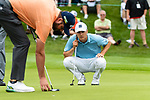 CROMWELL, CT. 20 June 2019-062019 - PGA Tour player Jordan Speith right, looks over his birdie putt, as Marc Leishman marks his ball, on the first hole, during the first round of the Travelers Championship at TPC River Highlands in Cromwell on Thursday. Bill Shettle Republican-American
