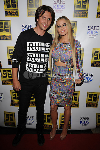 BOCA RATON - OCTOBER 23:  Jonathan Cheban and Carmen Electra attend Fright Night at the Blue Martini on January 23, 2014 in Boca Raton, Florida.Credit: mpi04/MediaPunch