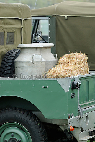 Historic 1950s Landrover Series One 80 inch transporting milk jaws and bales of straw in an age related Brookhouse trailer. Europe, England, UK. --- No releases available. Automotive trademarks are the property of the trademark holder, authorization may be needed for some uses.