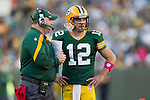 Green Bay Packers quarterback Aaron Rodgers (12) listens to Head Coach Mike McCarthy during a Week 4 NFL football game against the Denver Broncos on October 2, 2011 in Green Bay, Wisconsin. The Packers won 49-23. (AP Photo/David Stluka)