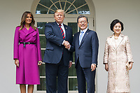 US President Donald J. Trump (C-L) and First Lady Melania Trump (L) welcome Korean President Moon Jae-in (C-R) and Mrs. Kim Jung-sook (R) to the Colonnade of the White House in Washington, DC, USA, 11 April 2019. President Moon is expected to ask President Trump to reduce sanctions on North Korea in an attempt to jump start nuclear negotiations between North Korea and the US.<br /> CAP/MPI/RS<br /> ©RS/MPI/Capital Pictures