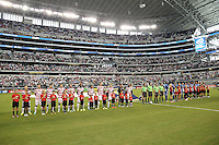 USMNT and Honduras team during the American national anthem prior to the match on July 24, 2013 at Dallas Cowboys Stadium in Arlington, TX.