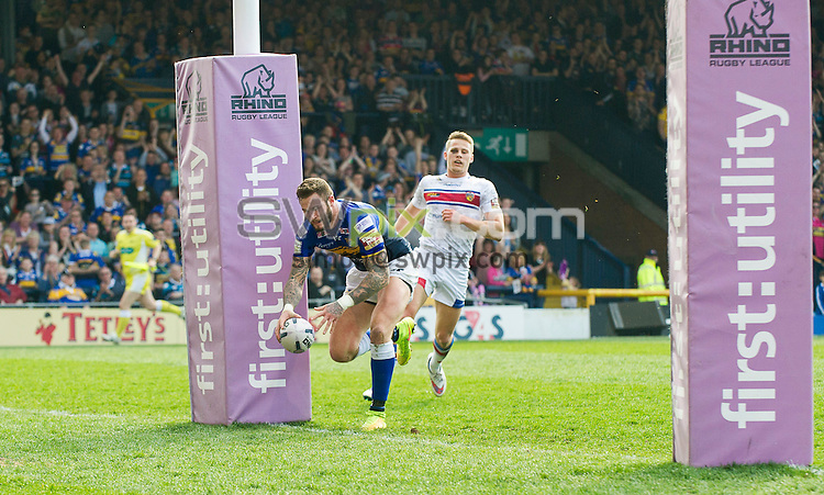 Picture by Allan McKenzie/SWpix.com - 06/04/2015 - Rugby League - First Utility Super League - Leeds Rhinos v Wakefield Trinity Wildcats - Headingley Carnegie Stadium, Leeds, England - Leeds's Zak Hardaker scores for Leeds.