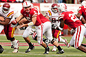24 October 2009: Nebraska quarterback Zac Lee hands the ball off to Nebraska running back Dontrayevous Robinson in the game against Iowa State at Memorial Stadium, Lincoln, Nebraska. Iowa State defeated Nebraska 9 to 7.