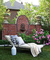 A sun-lounger in a garden setting, an ideal spot for relaxing in the sunshine.
