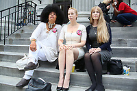 NORRISTOWN, PA - JUNE 16 : Lili Bernaro, Caroline Heldman and Therese Serignese sit on the steps of the Montgomery County Courthouse on the tenth day of Bill Cosby's sexual assault trial and the fourth full day of jury deliberation on June 16, 2017 in Norristown, Pennsylvania.  photo credit  Star Shooter/MediaPunch