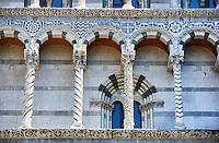 Detail of the 13th century Romaesque arcade pillars, sculptures and inlaid depictions of animals of the Cattedrale di San Martino,  Duomo of Lucca, Tunscany, Italy,