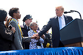 President Donald Trump greets the family of slain New York Police Detective Miosotis Familia, who was killed in the line of duty, as he delivers remarks at the 37th Annual National Peace Officers' Memorial Service at the U.S. Capitol Building on May 15, 2018 in Washington, D.C. <br /> Credit: Kevin Dietsch / Pool via CNP