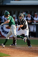 UCF Knights catcher Ben McCabe (40) tags Ryan McGee (4) during a game against the Siena Saints on February 17, 2019 at John Euliano Park in Orlando, Florida.  UCF defeated Siena 7-1.  (Mike Janes/Four Seam Images)