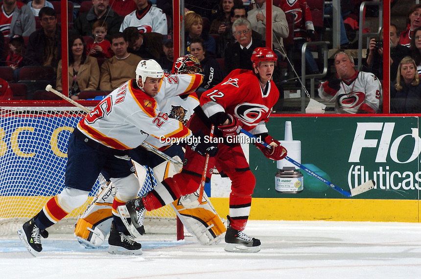 Florida Panthers' defenseman Mike Van Ryn (26) tries to move Carolina Hurricanes' forward Eric Staal (12) out of the crease as goaltender Roberto Luongo watches during their game Friday, March 3, 2006 at the RBC Center in Raleigh, NC. Carolina won 5-2.
