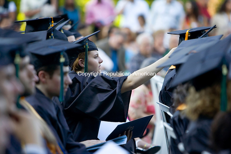WATERBURY, CT- 29 MAY 2008- 052908JT12- <br /> Graduate Lauren Murray adjusts the cap of certificate recipient Khin Swe during commencement ceremonies on Thursday at Naugatuck Valley Community College in Waterbury. Visit www.rep-am.com to see a photo gallery of the event.<br /> Josalee Thrift / Republican-American