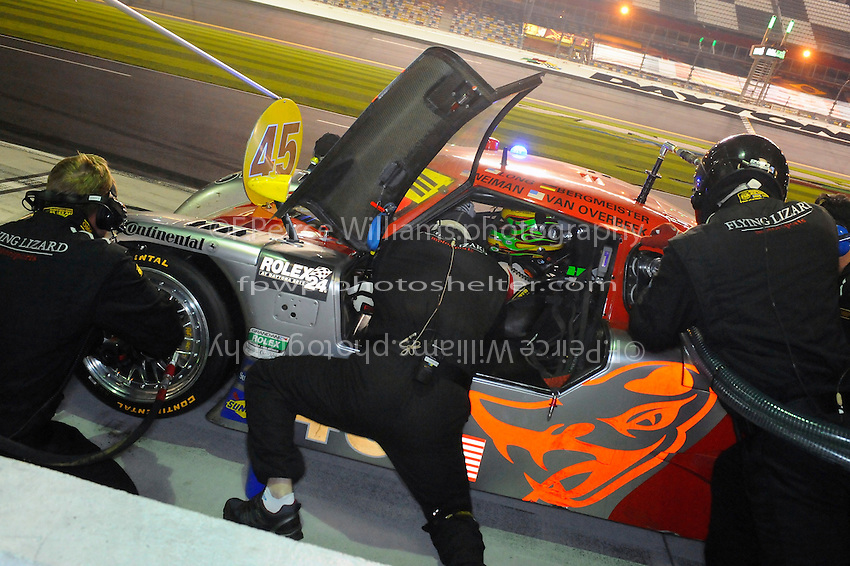 Patrick Long gets straps into the #45 Flying Lizard Porsche/Riley for a early morning stint.