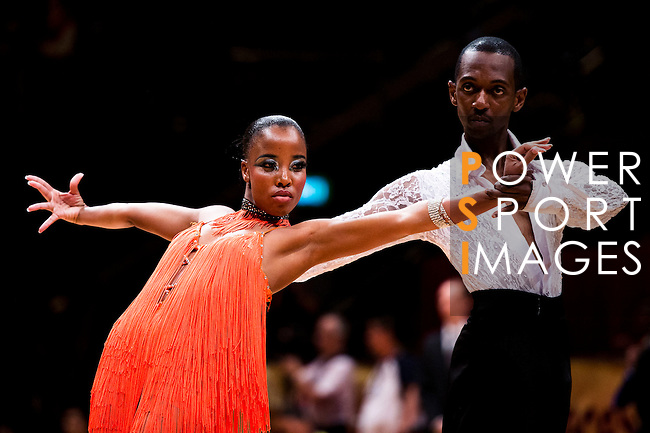 Minenhle Gazu and Keneilwe Baloyi of South Africa during the WDSF GrandSlam Latin on the Day 1 of the WDSF GrandSlam Hong Kong 2014 on May 31, 2014 at the Queen Elizabeth Stadium Arena in Hong Kong, China. Photo by AItor Alcalde / Power Sport Images