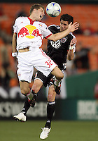 Chris Pontius #13 of D.C. United goes for a header with Luke Sassano #32 of New York Red Bulls during a U.S. Open Cup match at RFK Stadium on May 20 2009, in Washington D.C. D.C. United won 5-3.