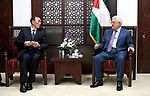 Palestinian President Mahmoud Abbas meets with Vice chairman of the Standing Committee of the National People's Congress (NPC) Kiang Bunkog, in the West bank city of Ramallah, on July 12, 2017. Photo by Osama Falah
