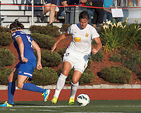 Western New York Flash forward Abby Wambach (20) brings the ball forward.  In a National Women's Soccer League (NWSL) match, Boston Breakers (blue) tied Western New York Flash (white), 2-2, at Dilboy Stadium on August 3, 2013.