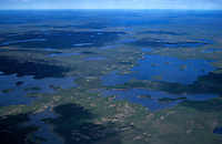731000156 an aerial view of the tundra taiga forest and glacial ponds in the northwest territories in canada