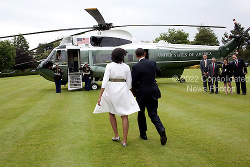 Colleville-sur-Mer, France - June 6, 2009 -- United States President Barack Obama and First Lady Michelle Obama walk towards Marine One as they leave Normandy for Paris on Saturday, June 6, 2009.  Seeing them off are National Security Advisor James Jones, Chief of Staff Rahm Emmanuel, and Senior Advisors Valerie Jarrett and David Axelrod. .Mandatory Credit: Pete Souza - White House via CNP