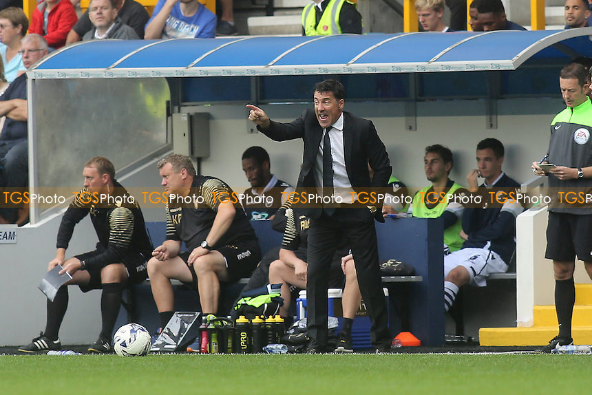 Chesterfield Manager, Dean Saunders, issues some instructions from the sidelines during Millwall vs Chesterfield, Sky Bet League 1 Football at The Den, London, England on 29/08/2015