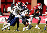 Florida International University Golden Panthers versus the University of Arkansas Razorbacks at Donald W. Reynolds Razorback Stadium, Fayetteville, Arkansas on Saturday, October 27, 2007.  The Razorbacks defeated the Golden Panthers, 58-10...FIU senior defensive back Cory Fleming (30) (Orlando, Fla.) tackles Arkansas tailback Felix Jones (25) with FIU sophomore linebacker Scott Bryant (44) (Lakeland, Fla.) in pursuit.