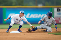 Mattingly Romanin (28) of the Bluefield Blue Jays is tagged out by Burlington Royals shortstop Brian Bien (3) as he tries to steal second base at Burlington Athletic Park on July 1, 2015 in Burlington, North Carolina.  The Royals defeated the Blue Jays 5-4. (Brian Westerholt/Four Seam Images)