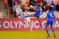 HOUSTON, TX - JANUARY 28: Kelly O'Hara #5 of the United States sends a cross ball into the box past Roseline Eloissaint #11 of Haiti during a game between Haiti and USWNT at BBVA Stadium on January 28, 2020 in Houston, Texas.