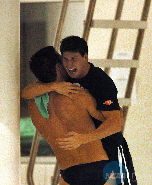 25 MARCH 2006: Auburn University swim team  member John Scott hugs diver Steven Segerlin moment after Segerlin won the platform diving event during the 2006 Division 1 Men's Swimming and Diving Championship at the Georgia Tech Aquatic Center at Georgia Tech in Atlanta, Ga. Auburn won the team championship with a score of 480.5 Erik S. Lesser/NCAA Photos