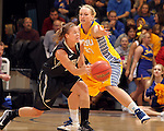 SIOUX FALLS, SD - MARCH 9:  Leah Dietel #21 from South Dakota State University applies pressure to Peyton Apsey #22 from Oakland University in the first half of their game at the Sioux Falls Arena during the 2013 Summit League Tournament Saturday afternoon. (Photo by Dave Eggen/Inertia)