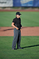 Umpire Matt Herrera handles the calls on the bases during the game between the Ogden Raptors and the Orem Owlz at Lindquist Field on June 19, 2018 in Ogden, Utah. The Raptors defeated the Owlz 7-2. (Stephen Smith/Four Seam Images)