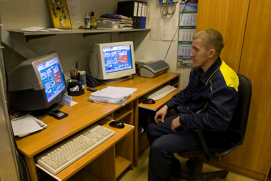 Tsiglomen, Arkhangelsk, Russia, 11/12/2007..Boiler operator Alexander Kudryashov in the control room inside the new BWW boiler house.